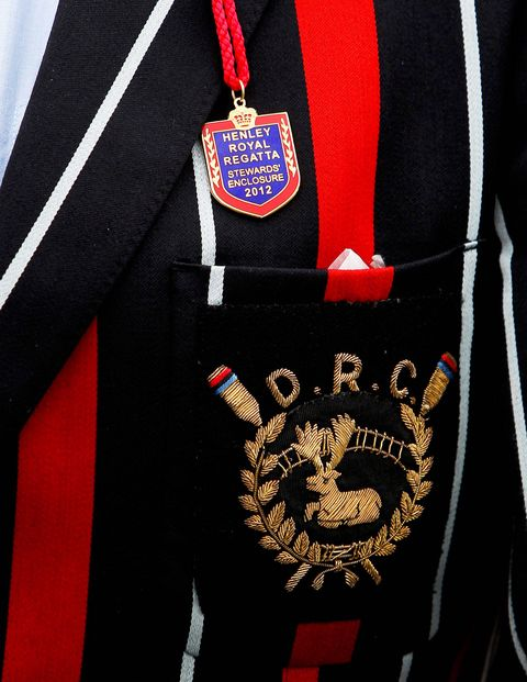 <p>A Stewards' Enclosure badge pinned to a rowing club blazer.</p>