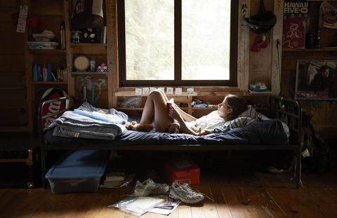 Julia from Massachusetts delves into a paperback in her well-stocked abode at Camp Walden.  Located in Denmark, Maine, the girls camp has been run by the Herz family for four generations.