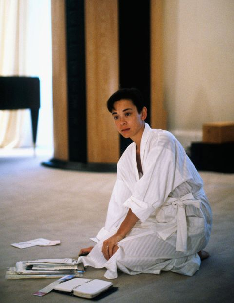 Sitting, Performance art, Costume, Barefoot, Robe,