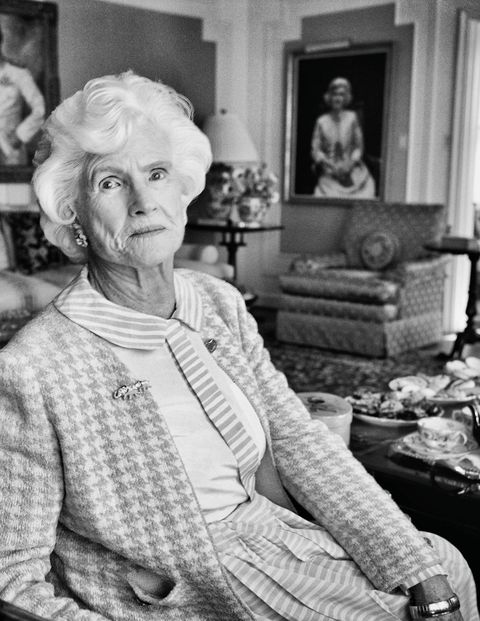 "Roberta McCain, in her living room near portraits of herself and of her father-in-law, Admiral John S. ""Slew"" McCain Sr. The latter was painted by Thomas E. Stephens in 1943."