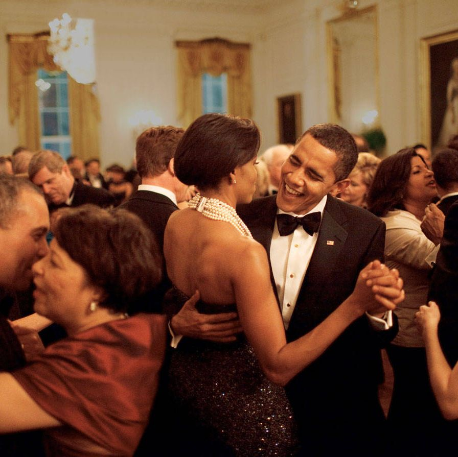 First couple Barack and Michelle Obama, who are known for cutting a rug at White House events, dance while Earth, Wind & Fire performs at the 2009 Governors' Ball.