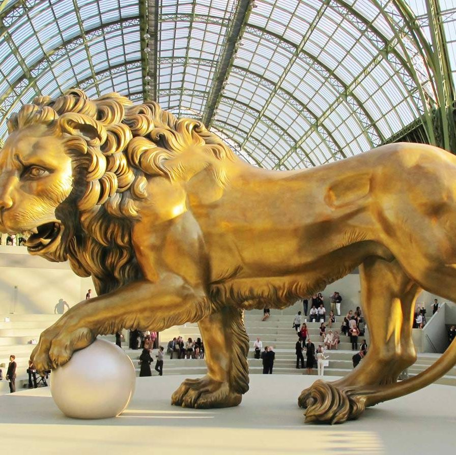 Chanel was a Leo — born August 19, 1883 — and the lion can be spotted on jacket buttons, as a coffee-table object in her apartment, and as the centerpiece in a Chanel fashion show in the Grand Palais.
