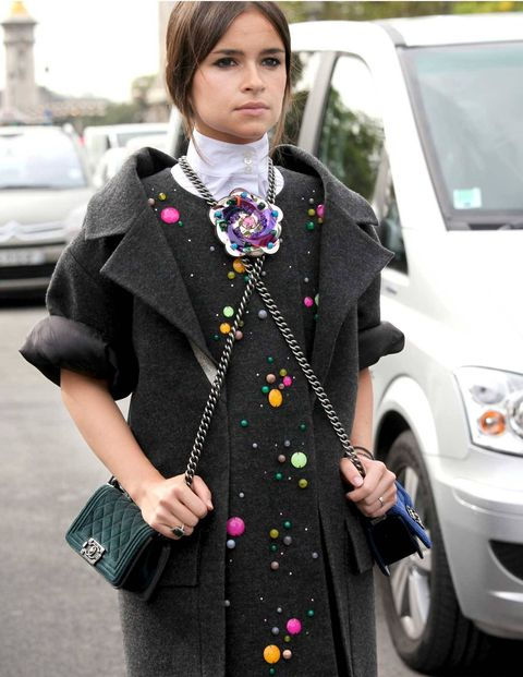 The idea that two is better than one goes back to the Bible (see Noah's Ark, Ecclesiastes), but it maintains its hold in more secular circles as well (the Doublemint twins, Taylor Swift lyrics). it also applies to Chanel's Boy Flap bags, seen worn  deux at the most recent Paris shows by Russian blogger Miroslava Duma.