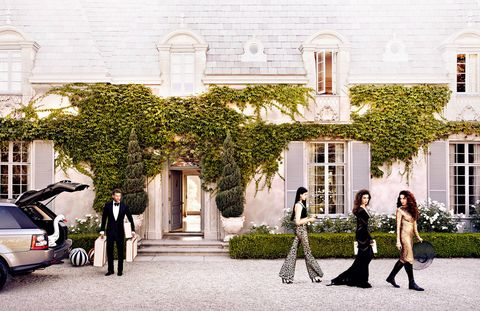 What do you need for a fairy tale? Start with a castle, a beauty or three, and inflatable waterfowl. From left: The butler, Andie MacDowell's daughters Margaret and Rainey Qualley, and MacDowell herself. On him, Tom Ford tuxedo ($4,790), evening shirt ($790), bow tie ($190), and shoes ($1,350). On Margaret, Wes Gordon pants ($925); Cushnie et Ochs bra top ($495); Gucci sandals ($795); Dolce & Gabbana earrings ($496). On Rainey, Pucci dress (price on request); Auden earrings ($398). On MacDowell, Tom Ford dress ($24,480); Gucci boots ($17,950); Patricia Underwood hat ($460).