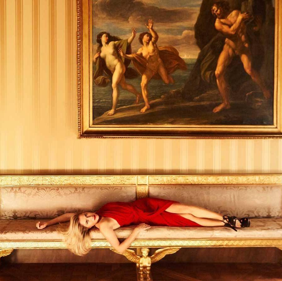 Pepi Marchetti Franchi, director of the Gagosian Gallery in Rome, takes her rightful place among the artworks at the Palazzo Torlonia.Max Mara Elegante silk dress ($1,250).