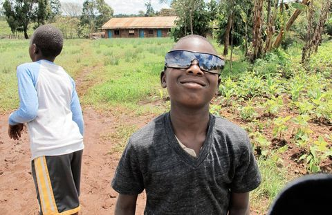 A boy models his sunglasses.