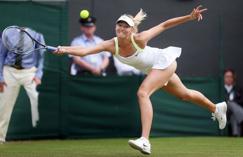 Maria Sharapova makes a run for the ball, grunting all the way.