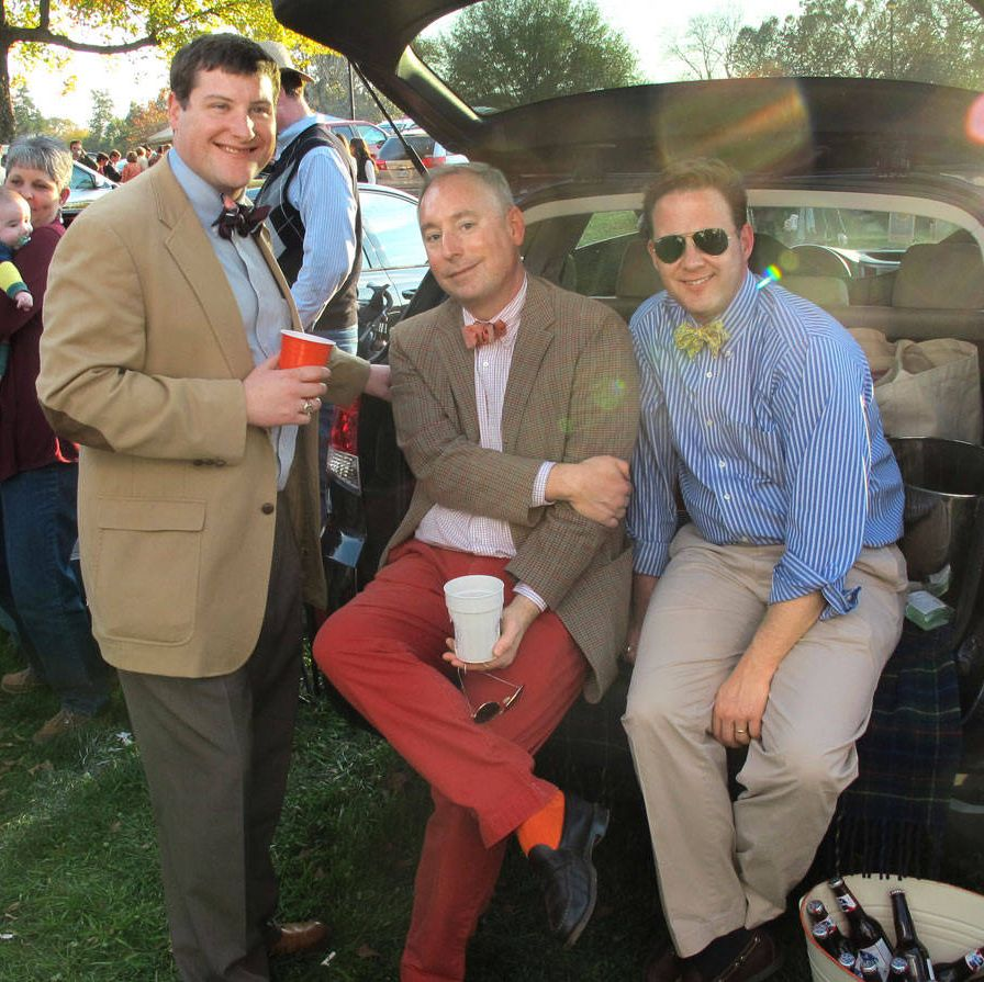 Demas Boudreaux ('02), David Whaley ('90), and Rob Wade ('91) tailgate — literally.