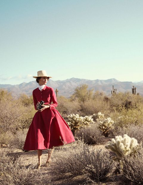 Hat, Dress, People in nature, Fashion accessory, Sun hat, Grassland, One-piece garment, Vintage clothing, Day dress, Spring,