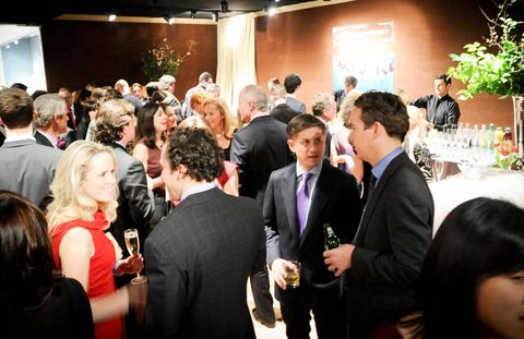 Event, Coat, Suit, Formal wear, Tie, Wine glass, Drink, Conversation, Houseplant, Function hall,