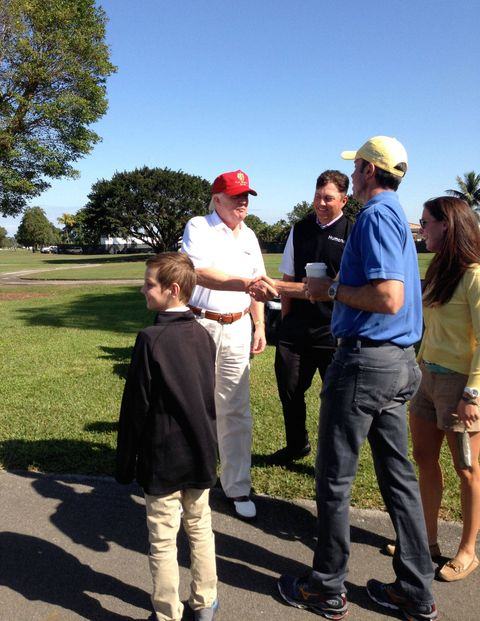 Donald Trump greets PGA golfers Bo Van Pelt and Matt Kuchar (in yellow hat).