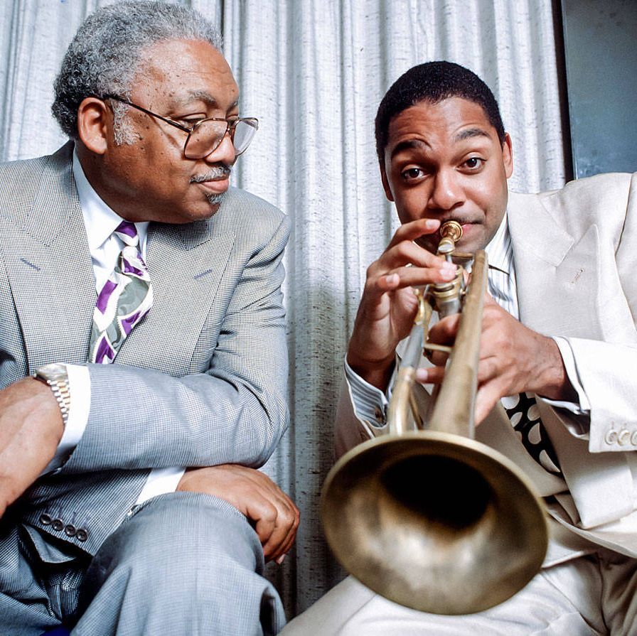 Jazz is their business, and they've monopolized it. Pianist Ellis Jr. — son of Ellis Sr., a civil rights activist — confines his efforts mostly to teaching in his native New Orleans, but his four musical children (out of six) barnstorm far and wide. Wynton (trumpet) is artistic and managing director of Jazz at Lincoln Center and a fixture on PBS and NPR&#x3B; Branford (saxophone) is a former Tonight Show bandleader&#x3B; Delfeayo (trombone) produces records&#x3B; and Jason (drums and vibes) is a respected sideman. Wynton supports Music for Tomorrow, while Branford promotes the Robin Hood foundation and started the Musicians' Village — part of the New Orleans Area Habitat for Humanity's post-Katrina efforts — with fellow musician and New Orleans native Harry Connick Jr. Together the family received a 2011 National Endowment for the Arts Jazz Masters Award.Ellis Marsalis Jr. with son Wynton, backstage at the Blue Note jazz club in New York City, 1990.