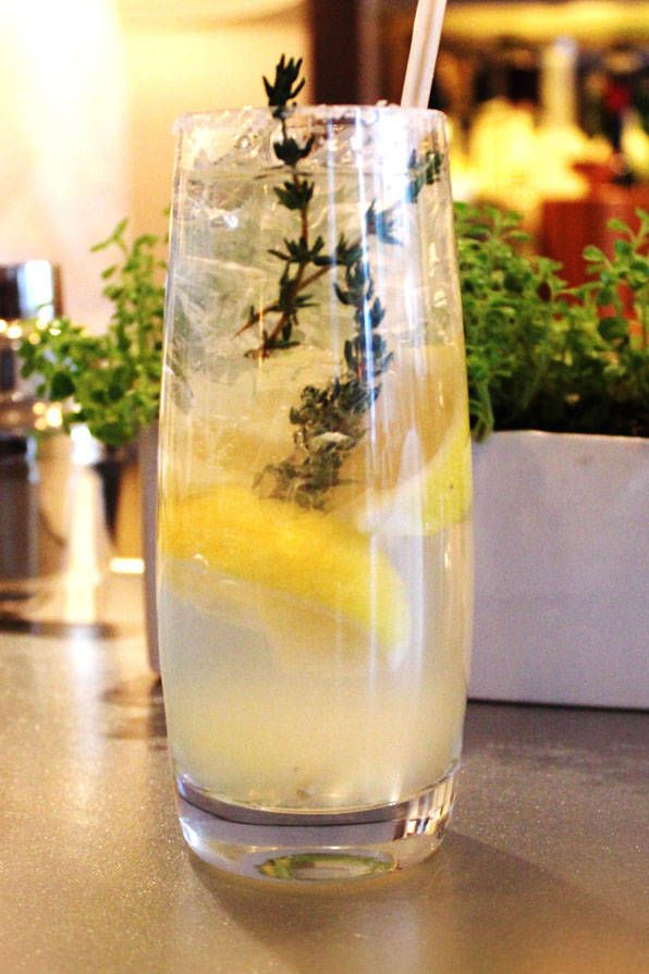 Jean-Georges' hard lemonade. This refreshing spiked lemonade comes from Chef Jean-Georges Vongerichten. 3 lemon wedges sugar .25 cup Lemon-Thyme Syrup.25 cup citrus vodka .25 cup club soda1 sprig fresh thyme, preferably lemon thymeRun 1 lemon wedge over the rim of a highball glass; dip the rim into sugar. Reserve the lemon wedge. Put the remaining 2 lemon wedges in a cocktail shaker along with the syrup and vodka. Muddle hard, breaking the lemon skins to release their oils. Cover and shake.Carefully fill the rimmed glass with ice. Pour the syrup mixture into the glass, lemon wedges and all. Top off with the club soda, the squeeze the reserved lemon wedge over before dropping it into the glass. Garnish with the thyme sprig and serve immediately.Lemon-Thyme SyrupMakes 1 cup.75 cup sugar1 small bunch fresh thyme, preferably lemon thyme (.5 ounce)In a small saucepan, heat 1 cup water and the sugar to boiling, stirring to dissolve the sugar. Add the thyme, remove from the heat, and let stand until cool. Strain through a fine-mesh sieve, pressing to extract as much liquid as possible. Cover and refrigerate for up to 3 days.