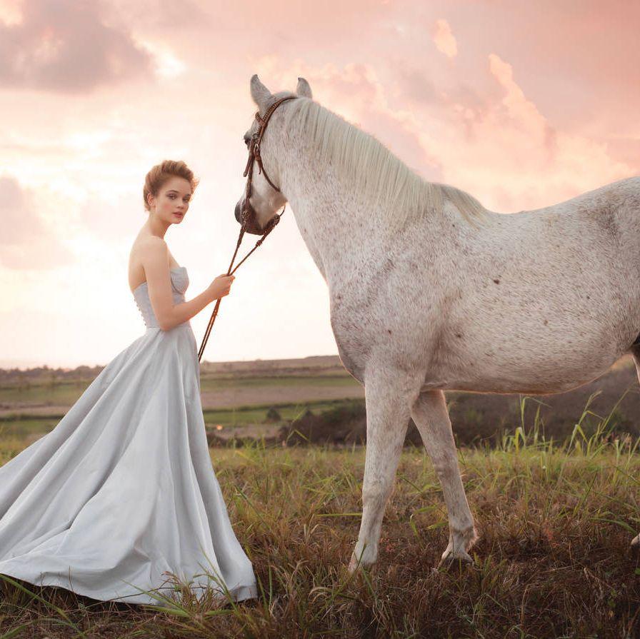 He may be a bit stubborn, but she knows she's found the perfect ride. Romona Keveza shantung taffeta dress ($5,495).