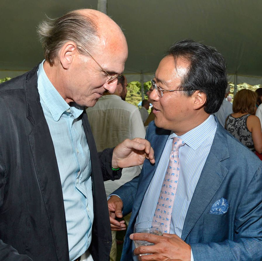 """On a sweltering day in the Berkshire Mountains, the gala co-chair Steve Weber preemptively declared the gala tent a """"no-tie-zone"""" then announced that the event had just raised $330,000 for the Boston Symphony Orchestra's artistic and educational endeavors. Following the announcement, many in attendance loosened their ties, but James Taylor, the erstwhile handyman (pictured here with Yo-Yo Ma), didn't have one on to begin with and continued to smile benignly beside his wife, Kim.The theme of the cocktail party and dinner was Russian Summer—which led to décor inspired by the colors and designs of Fabergé eggs, and rows of flowers, walls and tables draped in jewel-toned silks. Delicacies included pepper vodka-cured trout, chilled golden beet soup and halibut with Champagne and caviar cream sauce, followed by a Russian apricot torte.After the feasting, the BSO kicked off its 2013 season at Tanglewood with an all-Tchaikovsky concert featuring violinist Joshua Bell as soloist and conductor Rafael Frühbeck de Burgos. Soloist Bell gave an athletic account of the violin concerto in D. """"I love coming here,"""" he says—it was his 25th straight summer on the Tanglewood stage. """"It's such a beautiful place and a kind of constant for me."""" Long-time guest conductor Frühbeck de Burgos led the BSO in the Fifth Symphony with a quiet authority and an appropriately fiery touch."""