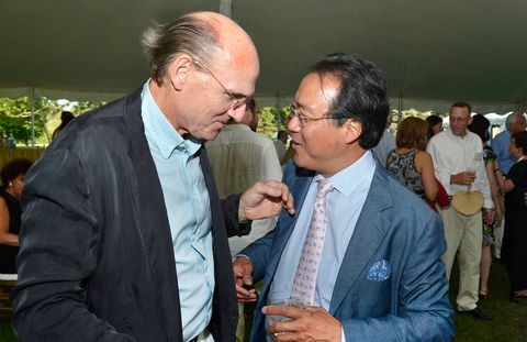 "On a sweltering day in the Berkshire Mountains, the gala co-chair Steve Weber preemptively declared the gala tent a ""no-tie-zone"" then announced that the event had just raised $330,000 for the Boston Symphony Orchestra's artistic and educational endeavors. Following the announcement, many in attendance loosened their ties, but James Taylor, the erstwhile handyman (pictured here with Yo-Yo Ma), didn't have one on to begin with and continued to smile benignly beside his wife, Kim.The theme of the cocktail party and dinner was Russian Summer—which led to décor inspired by the colors and designs of Fabergé eggs, and rows of flowers, walls and tables draped in jewel-toned silks. Delicacies included pepper vodka-cured trout, chilled golden beet soup and halibut with Champagne and caviar cream sauce, followed by a Russian apricot torte.After the feasting, the BSO kicked off its 2013 season at Tanglewood with an all-Tchaikovsky concert featuring violinist Joshua Bell as soloist and conductor Rafael Frühbeck de Burgos. Soloist Bell gave an athletic account of the violin concerto in D. ""I love coming here,"" he says—it was his 25th straight summer on the Tanglewood stage. ""It's such a beautiful place and a kind of constant for me."" Long-time guest conductor Frühbeck de Burgos led the BSO in the Fifth Symphony with a quiet authority and an appropriately fiery touch."