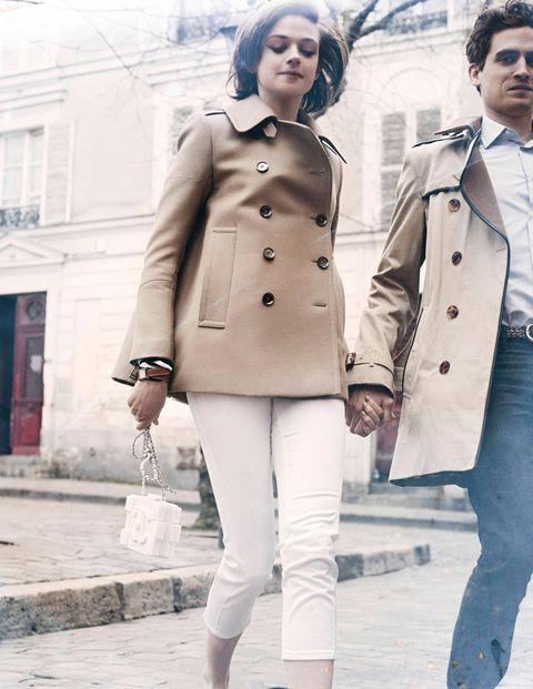 Like so many before her, she came to Paris with visions of Jean Seberg. On her, Belstaff coat ($1,895); J Brand jeans ($172); Hermès watch ($2,300); Chanel bag ($9,900). On him, Burberry London trench coat ($2,295); Hermès shirt, pants, and belt (prices on request).