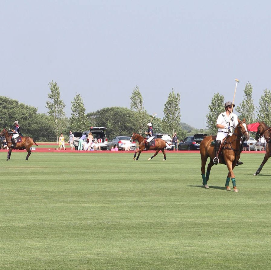 The kickoff of Bridgehampton Polo season, held at Two Trees Farm this past weekend and hosted by Escada and Town & Country, drew a resplendent and relaxed sort of polo fan. Christie Brinkley tossed the coin to start the very first match of the season, as T&C special projects editor Amanda Hearst and her mother, contributing editor Anne Hearst McInerney, Donna Karan, and Kelly Klein, all looked on (or, in some cases, continued to chat with other besties) from the sidelines.The VIP tent, across the field from the general admission area, sheltered a more select crowd than in previous years, smaller in number and more fashionably arrayed. The mix was a good one, with polo enthusiasts and social figures drawn from the immediate area and from nearby (or faraway, depending on the traffic) New York City.Matches will be played every Saturday through August 24.