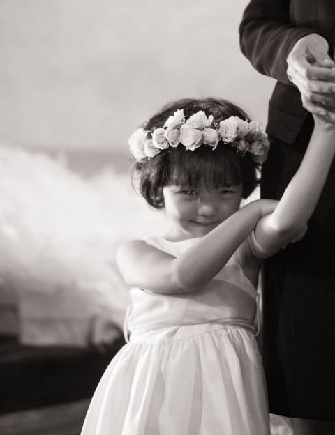 The flower girl wearing her fresh flower crown.