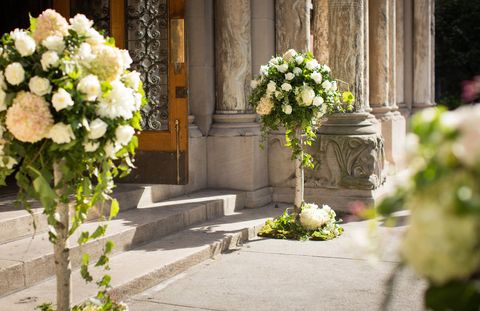 The overflowing white flowers at the entrance of St. Bart's church.