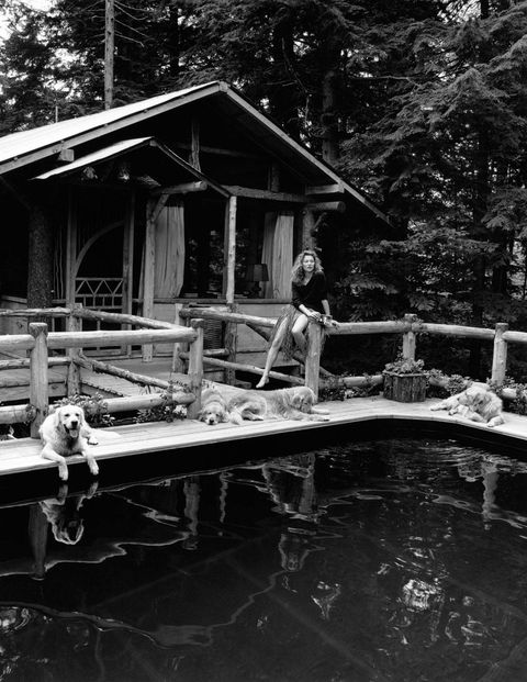 Kate Moss enjoys a quiet moment with friends at Camp Longwood's mountainside pool cabin, a favorite escape of both guests and hosts.