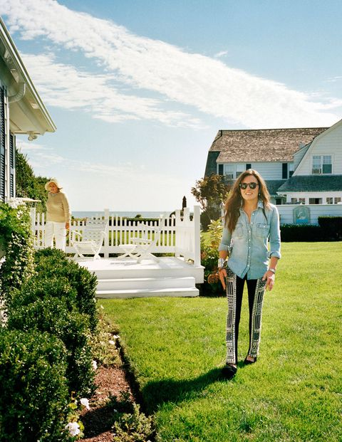Kick at the Cape Cod compound, with her grandmother Ethel in the background.J.Crew shirt ($78); Balmain pants ($6,000); Minnetonka shoes ($46); Dean Harris earrings ($695); Emilie Jean Tribal Jewelry cuff ($900) and bracelet ($290); Rolex watch ($5,800); Moscot sunglasses ($255).