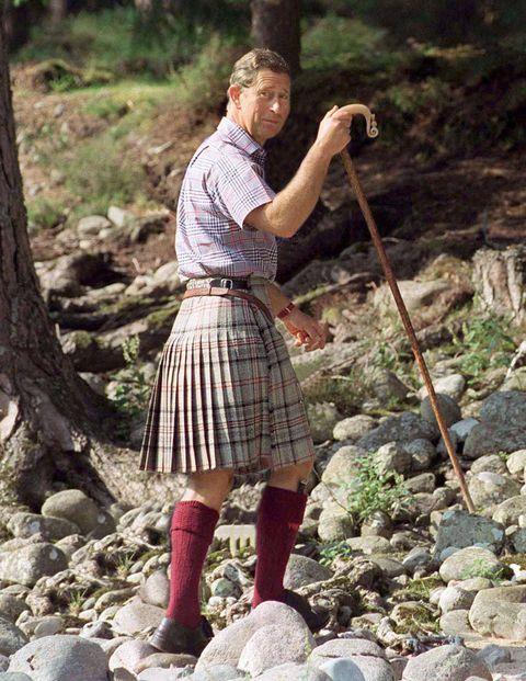 Prince Charles in a kilt and calf-length maroon socks.