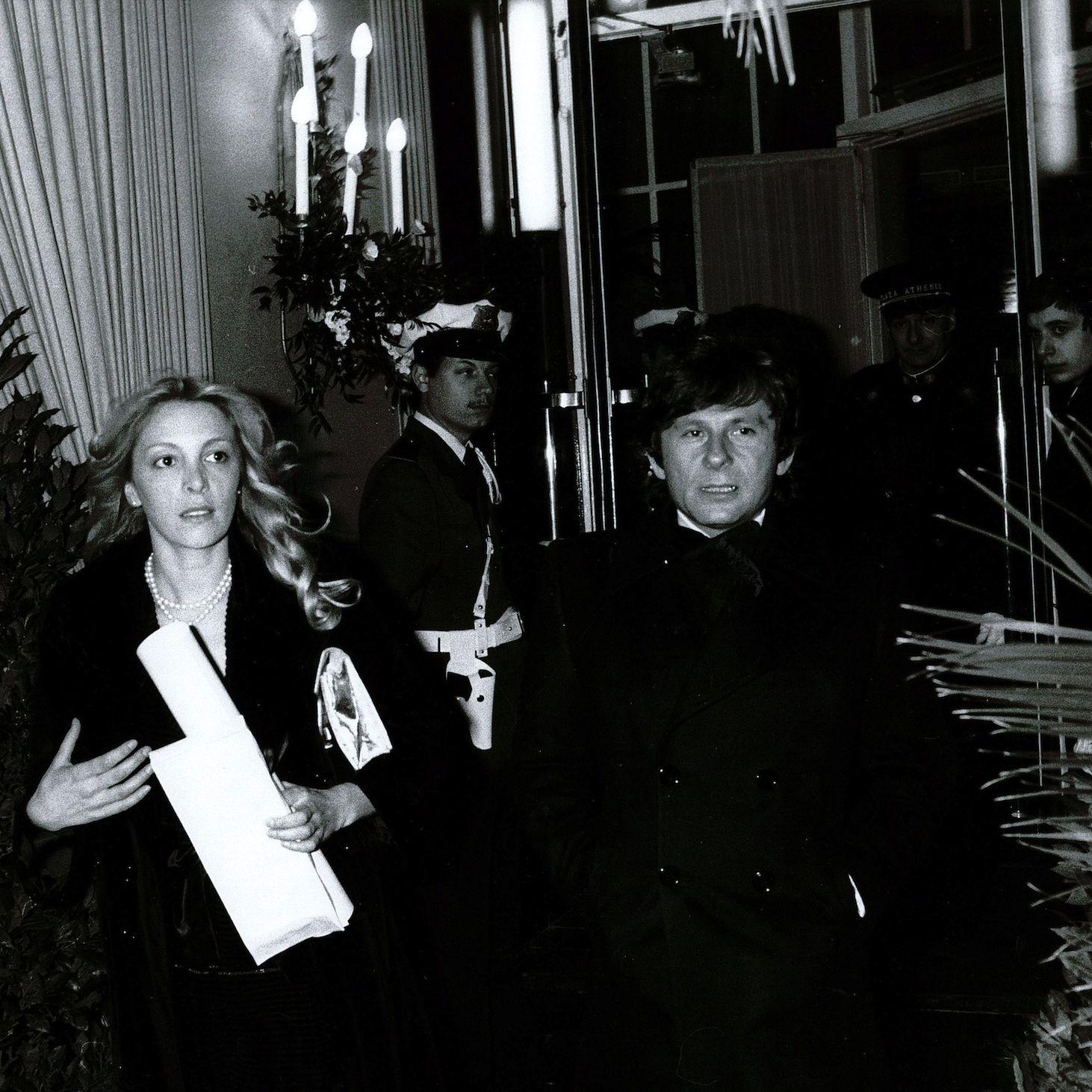 Roman Polanski and Catherine Paganesi seen exiting the hotel.