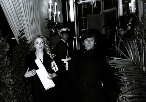Roman Polanski and Catherine Paganesi seen exiting the hotel.