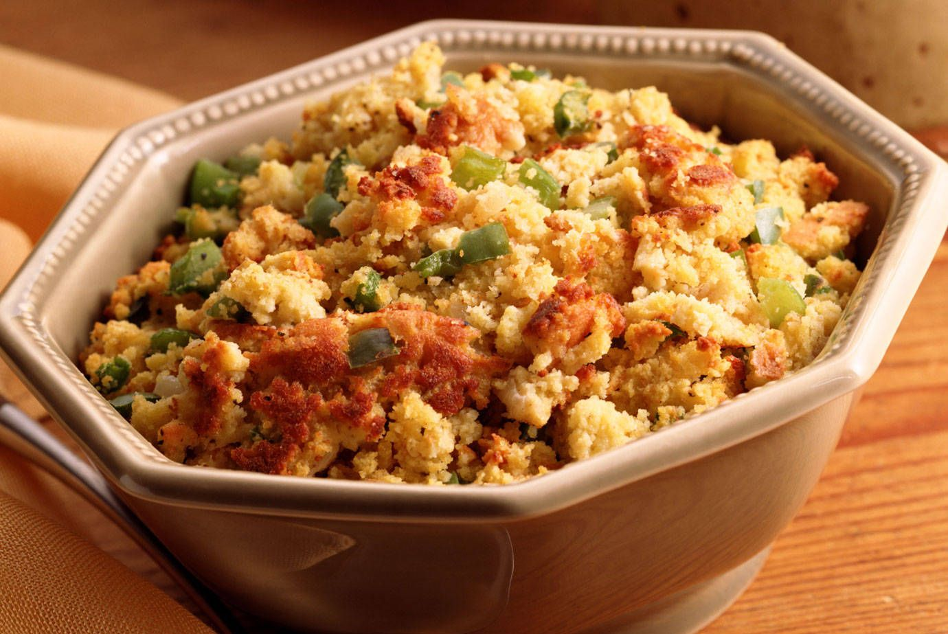Ingredients:2 tbsp vegetable oil2 cups turkey or chicken stock1/2 cup grated Parmesan cheese1/2 lb white mushrooms4 tbsp vegetable oilSalt/pepper to taste1/4 cup white wine1/2 cup chopped fresh parsley1 lb Italian sausage1 recipe Gluten-free cornbread  Directions:1. Chop or crumble the sausages, and sauté them in a frying pan with the 2 T vegetable oil, until fully cooked.2. Cut the cornbread into small 1 inch cubes, and set aside.3.Wash and slice the mushrooms, and sauté them in the 4 T vegetable oil4.Once they are browned add the wine, allow wine to cook off. Season with salt and pepper.5. Add mushrooms, sausage, cheese and stock to the cubed cornbread and stir together, mixture should hold together. Add more stock if necessary.6. Bake stuffing in a lightly greased 4qt baking dish, in a pre-heated 350 degree oven until firm.7. Serve stuffing warm.