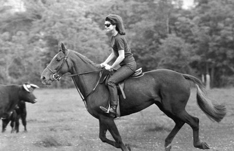 Jackie Kennedy rides a chestnut mare during a vacation in Ireland on June 20th, 1967.
