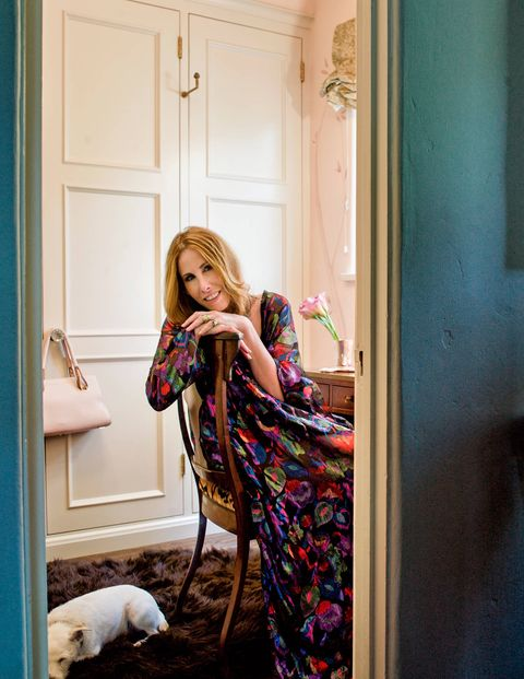 Stuart wears a vintage Yves Saint Laurent caftan in her dressing room.