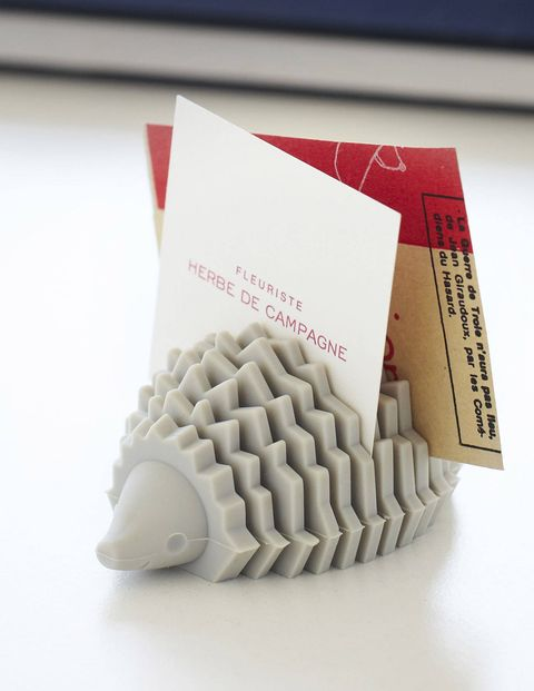 Keep small pieces of paper and loose business cards contained by treating yourself to fun organizational desk tools, like this Hedgehog Card Holder from MoMA.