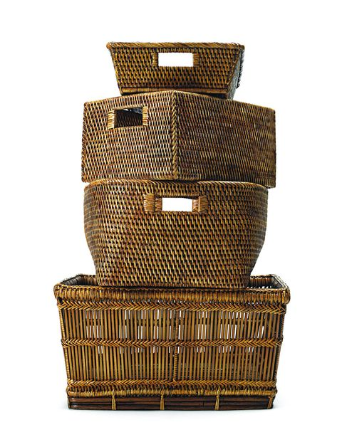 "Prevent the ""chairdrobe"" (def. ""The art of putting clothes on a chair to be used in place of closet or dresser; via urbandictionary.com) by purchasing new baskets, like these rattan rectangular linen baskets with handles from Waterworks."