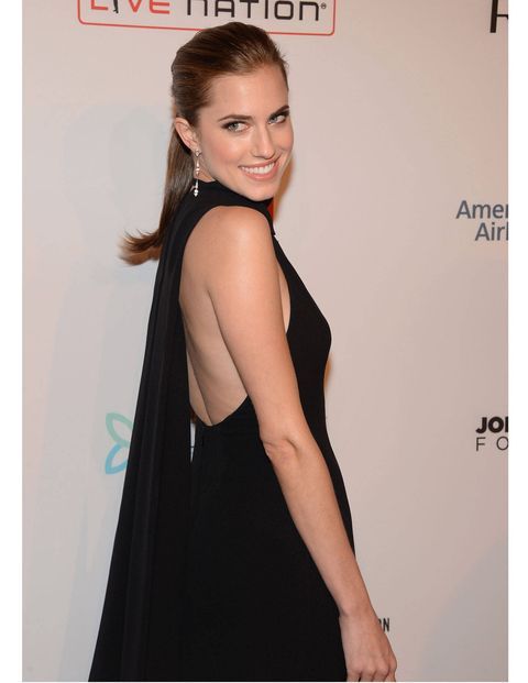 We know it's an obvious one, but never dismiss the timelessness and elegance of a black dress. For the Elton John AIDS Foundation Benefit, Williams chose a less traditional fit, with a high neckline and a sexy, draping back. We also recommend trying the retro ponytail. They're the new updo. You heard it here first.