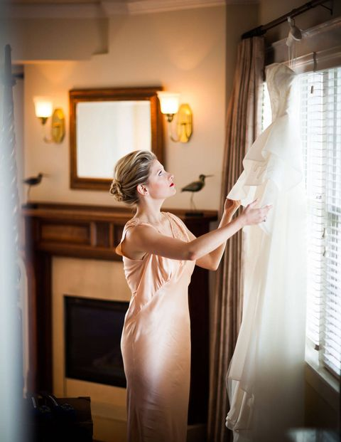 Courtney got ready in a pale peach vintage 1920's slip.