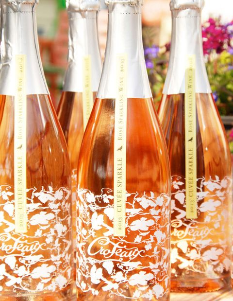 Liquid, Fluid, Glass bottle, Bottle, Glass, Barware, Drinkware, Orange, Amber, Peach,