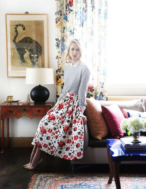 """Indre Rockefeller's attraction to color and print is clear to anyone who's lost an afternoon to Moda Operandi, the online home of straight-from-the-runway trunkshows, where she serves as General Merchandise Manager and Creative Director of trunkshows. At home, her styling sensibility and talent for scouting the up-and-coming is evident. """"It's important for me to have a home that is a collection of different eras, travels, and people,"""" Rockefeller says of her layered apartment, designed in collaboration with Jessica Stambaugh and Danielle Mastrangelo of Decorative Traces. Now, take a moment to get lost in her personal space that reflects her life.Indre Rockefeller wears a MSGM skirt, Alexander Wang sweater, and blouse by Equipment.Via ELLEDecor.com"""