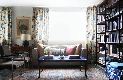 """Where she started in the space...""""Here, we started off with bigger pieces, like the coffee table and couch, they were kind of the clean slate to work off of. So it was very easy to add color and texture and print from there."""""""