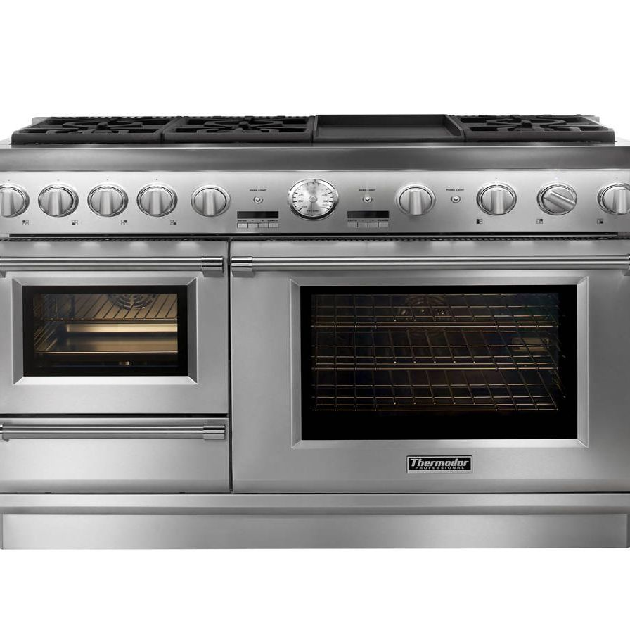 """The 48"""" Thermador Pro Grand Steam Range offers the first high-performance professional range with both a built-in steam and convection oven. In August 2014, the Pro Grand Steam Range will add a new feature, the Professional Grill, to accompany the seven different cooking options, including: Thermador's patented Star Burners with the ExtraLow simmering feature as well as the 22,000 BTUs power burner, a titanium griddle, a large capacity convection, a warming drawer, and their exclusive steam and convection oven."""