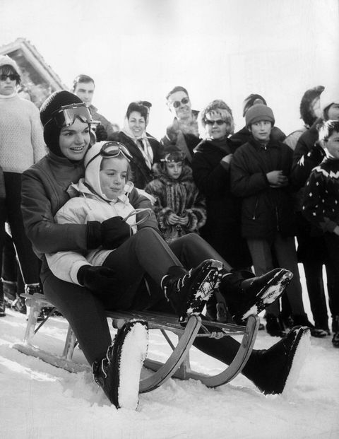 Jacqueline Bouvier Kennedy prepares for a sled ride with her daughter, Caroline.