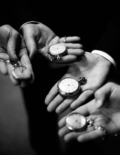 The groomsmen gifts: vintage pocket watches.