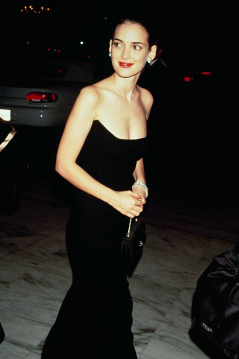 Where: Academy Awards in 1990Why: Ryder looks timeless in a strapless black gown and red lip.