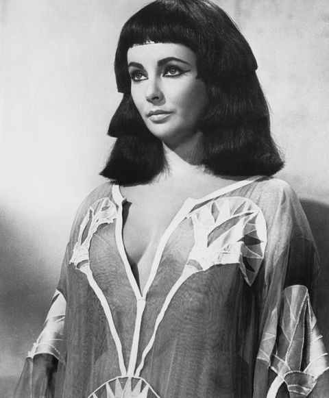 From the twilight of her youth to her final years, Elizabeth Taylor lived in caftans. Forget pajamas, nightgowns, and bathrobes, the star lounged around in nothing but the airy, ornamental dresses and never hesitated to go out in them, either. Naturally, she always accessorized with full face of makeup and fancy jewelry because that's what Elizabeth Taylor does.