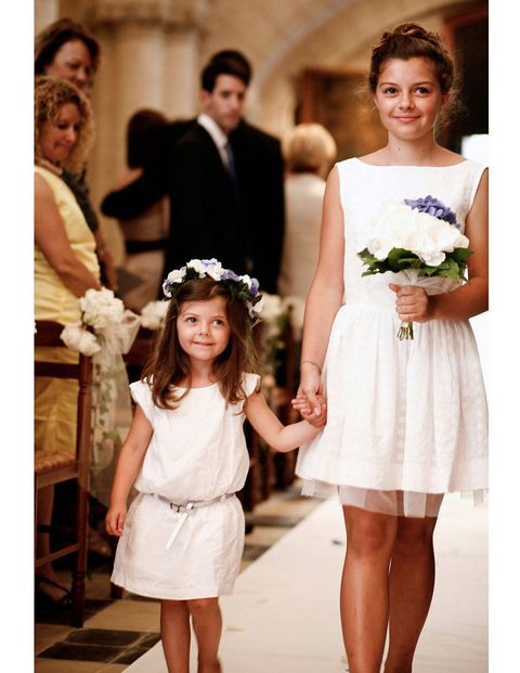 Adorable flower girls walking down the aisle.