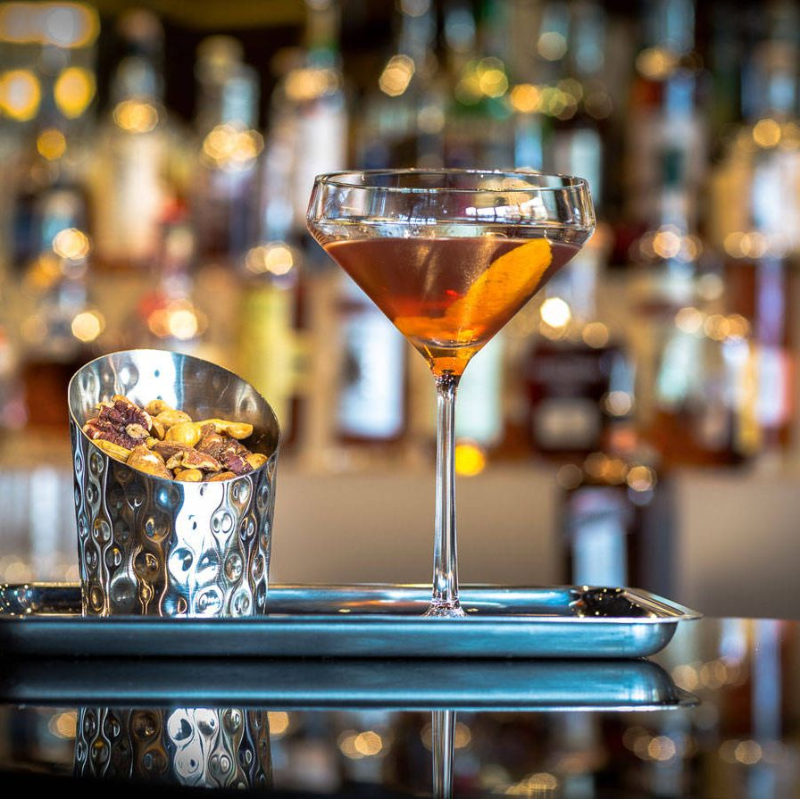 """The Rye Bar at Capella Washington D.C. features a barrel-aged Manhattan created by Capella Georgetown's food and beverage manager Will Rentschler. It incorporates Dad's Hat Rye, an artisanal small-batch whiskey from Pennsylvania, Dolin sweet vermouth, and Byrrh Quinquina, a sweet French aperitif. Fifteen gallons of the boozy concoction is aged for six weeks in an empty Dad's Hat whiskey barrel, providing a smooth final product that the hotel describes as having a """"deep body and a hint of vanilla and oak as a result from the barrels themselves."""" If you want to try making this cocktail or any of the following ones at home, consider using a 1-, 2-, 3-, or 5-liter barrel available for purchase from Tuthilltown Spirits. Recipe:2 Parts Dad's Hat Pennsylvania Rye1 Part Dolin Sweet Vermouth½ Part Byrrh QuinquinaAge in Charred White Oak barrels for 5-6 weeks. Once aged, pour 4oz. into glass with ice and stir until well chilled. Strain into chilled martini glass and add 3 drops of house-made orange bitters. Garnish with slice of orange peel."""