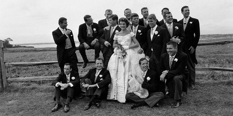 john f kennedy and jacqueline kennedy with their groomsmen on their wedding day in newport, rhode island jacqueline's dress was designed by ann lowe