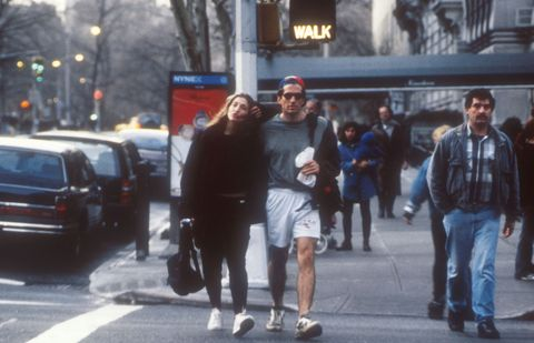 <p>John F. Kennedy, Jr. and Carolyn Bessette took a walk up Fifth Avenue—presumably post-workout—in 1996.</p>