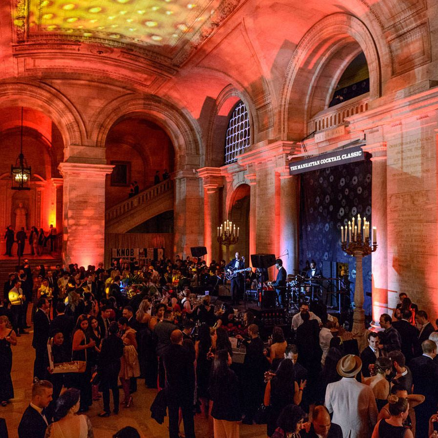 The Manhattan Cocktail Classic is five straight days of drinking, learning about, and paying homage to cocktails. The event that kicks off the annual festival, now in its fifth year, is a black-tie gala at the New York Public Libary.Last Friday, more than 3,000 guests sampled more than 100 different cocktails from 150 bartenders, resulting in a staggering number of opportunities to imbibe. In addition to offerings from big spirits brands like Campari and Grey Goose, one room on the third floor was entirely devoted to New York-produced spirits. Coco-Jack, also on the third floor, had a station showcasing their pineapple-opening product where attendees could open their own coconuts before taking them to-go along with straws for sipping.  We started the night in the Hangar 1 Vodka lounge on the second floor, which featured cocktails from six female bartenders from New York and San Francisco: Julie Reiner (Clover Club, NYC), Natasha David (Nitecap, NYC), Caitlin Laman (Trick Dog, San Francisco), Jane Elkins (Tavern on the Green, NYC), Pam Wiznitzer (The Dead Rabbit, NYC) and Lacy Hawkins (The NoMad, NYC). The girl power was in full force&#x3B; Caley Shoemaker, Hangar 1's new head distiller, is one of the first female distillers of her generation to lead a major spirits brand.Most striking to us was the boozy taste of many of the drinks, especially Reiner's Gotham cocktail: (Hangar 1 vodka, Cocchi Americano Rosa, Ramazzotti Amaro, and orange bitters). Who knew vodka drinks could be so palatable?Click through for a look at the rest of the evening.