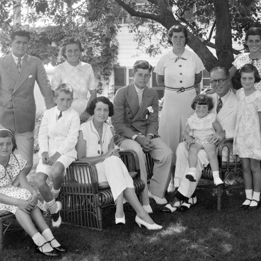 A portrait of the Kennedy Family. Seated from left are: Patricia Kennedy, Robert Kennedy , Rose Kennedy, John F Kennedy, Joseph P Kennedy Sr. with Edward Kennedy on his lap&#x3B; standing from left are: Joseph P Kennedy Jr., Kathleen Kennedy, Rosemary Kennedy, Eunice Kennedy, and Jean Kennedy.